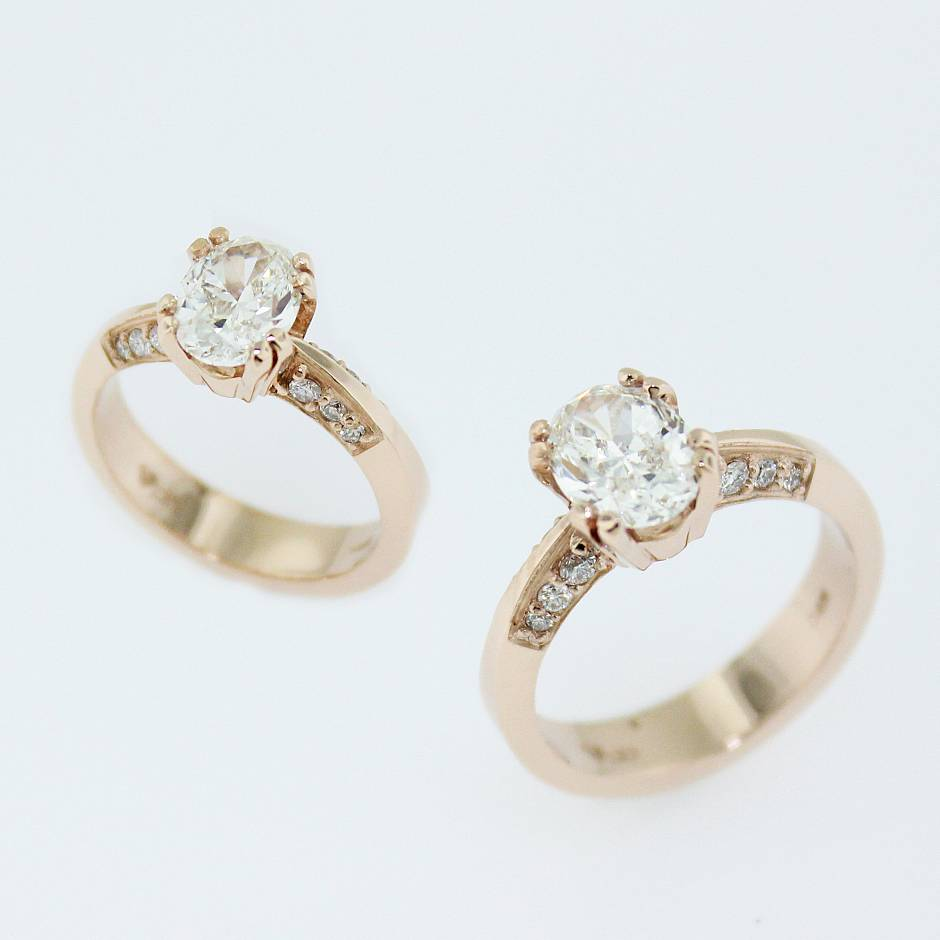Custom rose gold engagement ring -  1.01 carat oval brilliant diamond in the centre set in 14k rose gold.