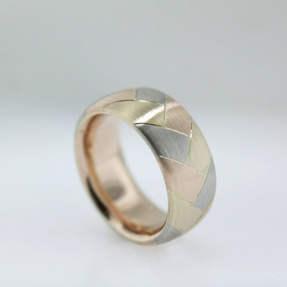 Tri-coloured wedding band. - Made up of over 24 individual cast components which were then soldered together and finished. A real challenge!