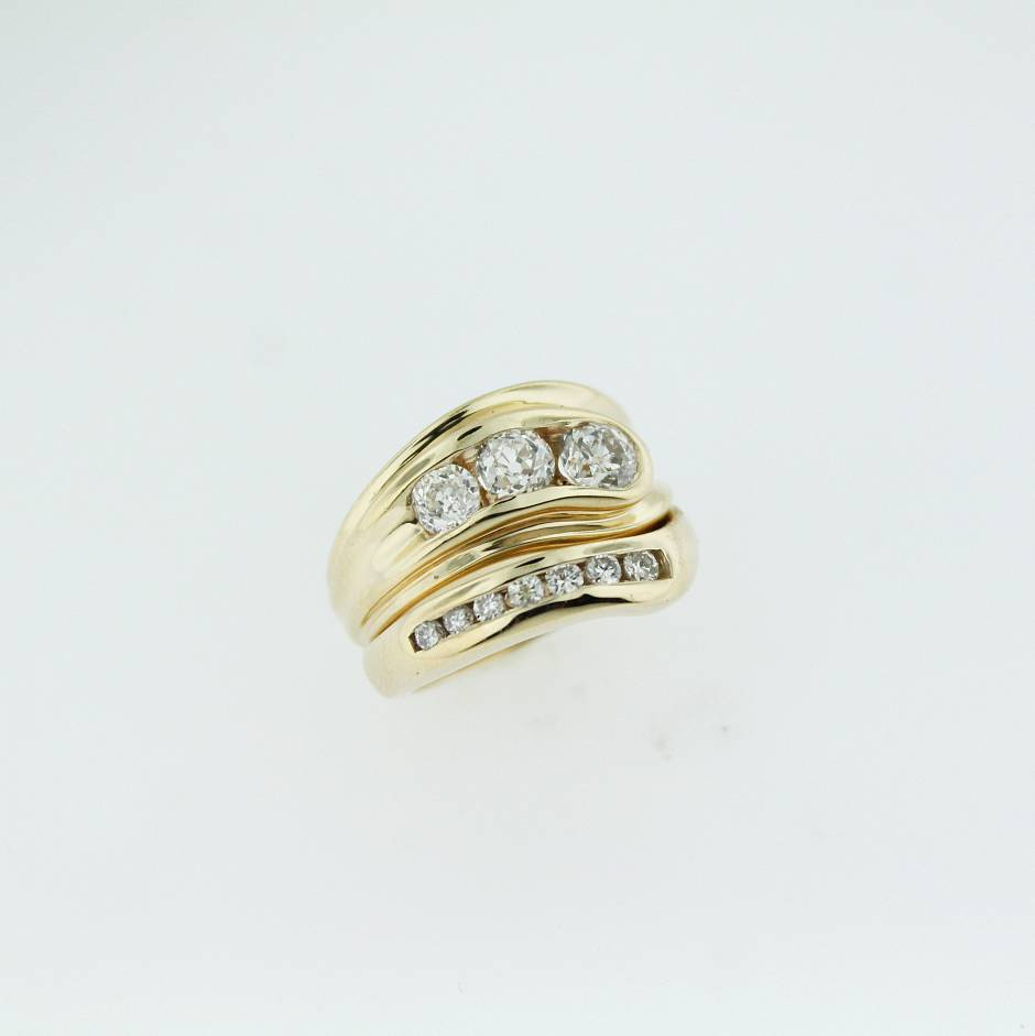 14k yellow gold engagement and wedding set.  - A Paul Richter signature style engagement ring and fitted wedding band.
