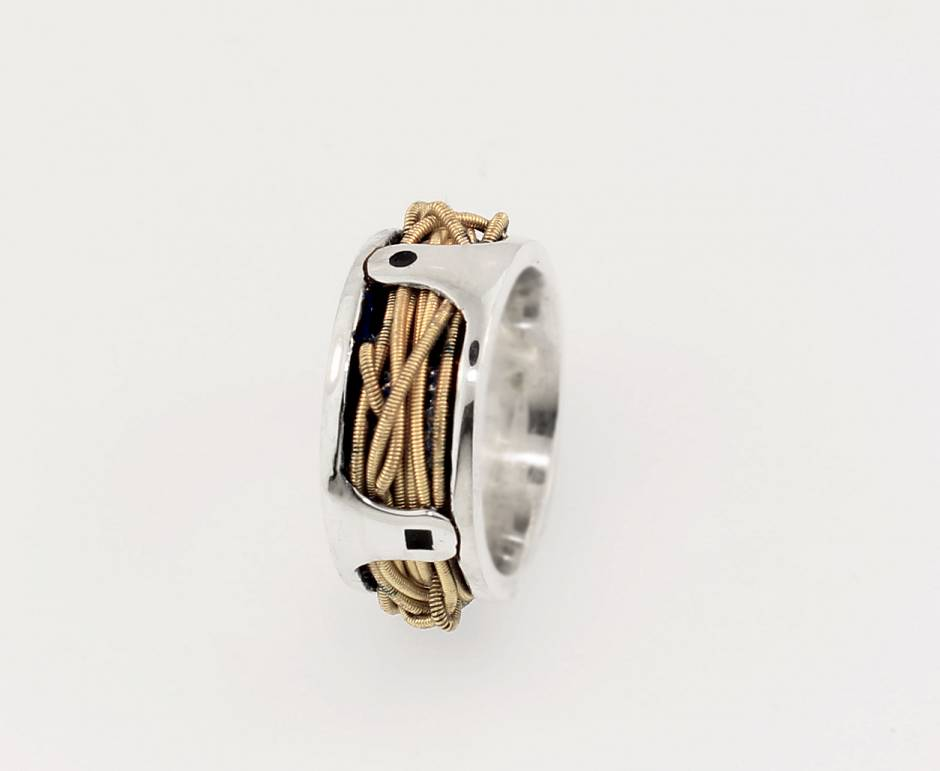 Sterling silver band  - with sentimental guitar string wrapped and riveted in place.