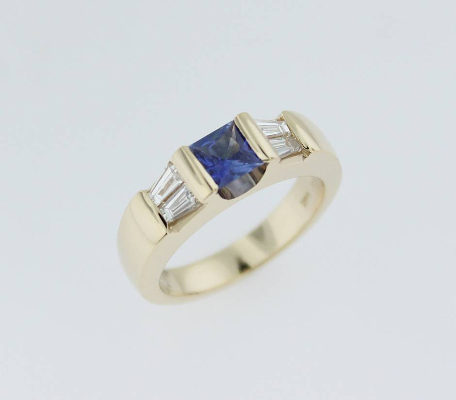 14k yellow gold engagement ring - - princess cut sapphire in the centre and four channel set tapered diamond baguettes