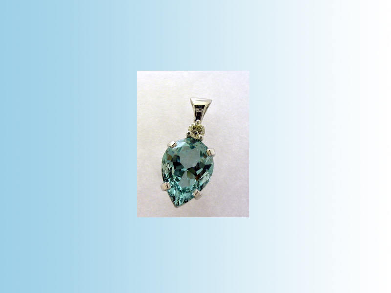 Aquamarine and Diamond pendant. - Hand crafted in 14K white gold and set with an 11ct pear shaped, natural Aquamarine with a diamond in the bail which moves.