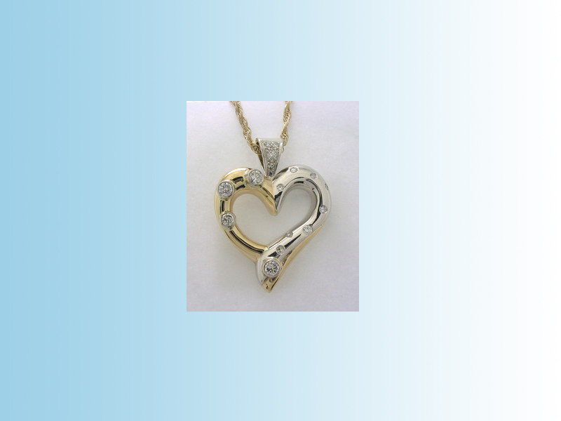 Diamond shaped pendant - Diamonds set randomly into a free-form 14K yellow and white gold pendant.
