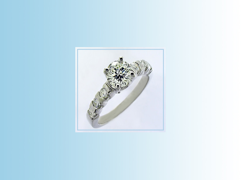 Diamond solitaire ENG005 - set in 14K white gold with round brilliant shoulder accent diamonds.