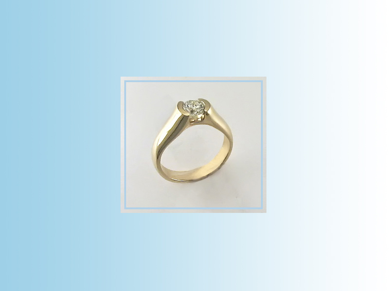 Diamond solitaire ENG007 - set in 14K yellow gold with a half bezel holding the diamond