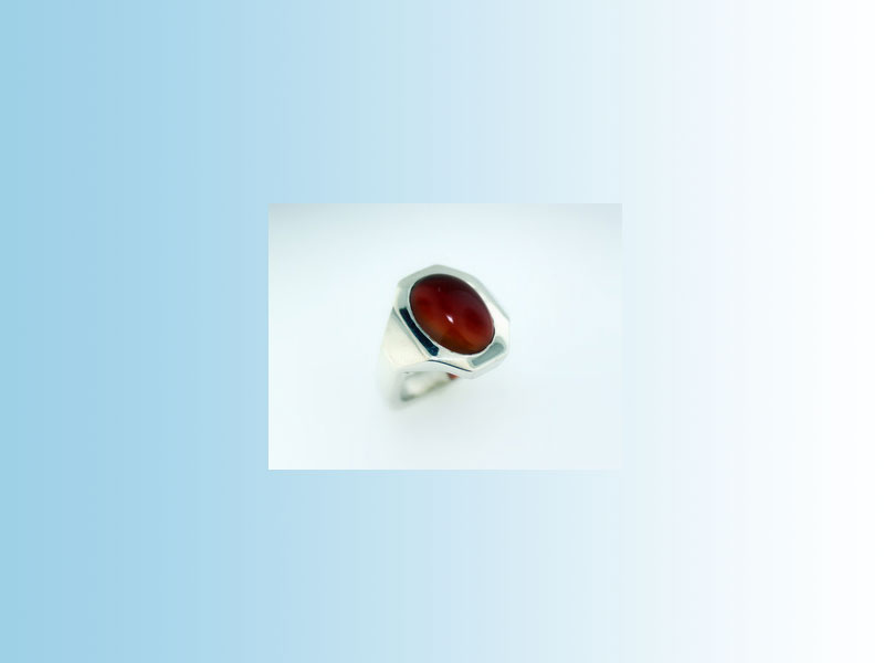 Oval Carnelian ring CRR006 - Sterling silver ring making use of the client's oval cabochon carnelian stone as provided.