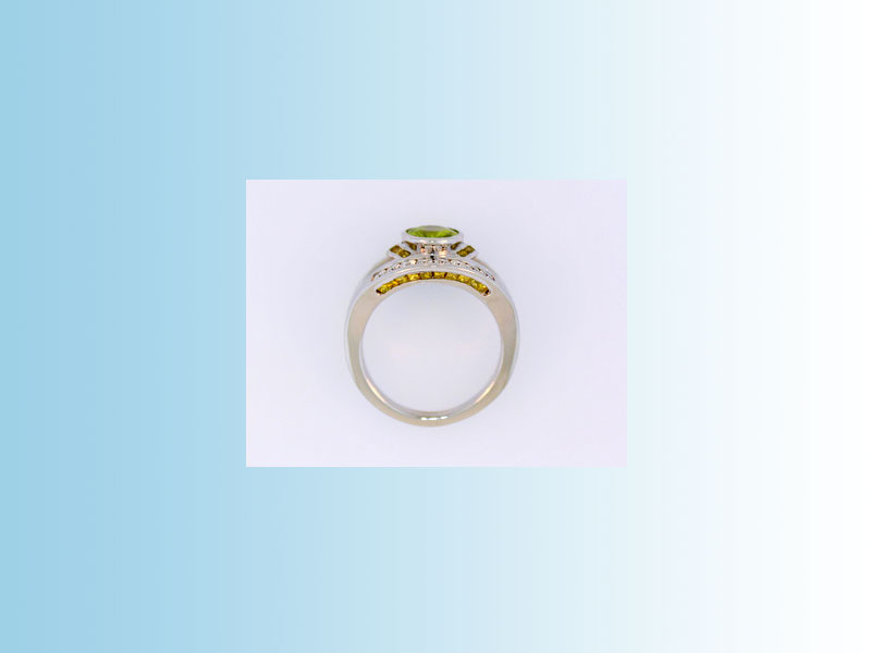 14K White Gold Sphene Ring BGS006 - Split shank design set with round brilliant white diamonds, princess cut yellow diamonds and an oval green sphene in a full bezel. Created for BLUSH JEWELLERY in Victoria, British Columbia. Contact us for more info.