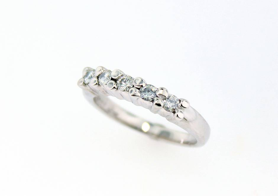 Common claw diamond wedding band - Set with white round brilliant cut diamonds. Picture here in 19K white gold. Any diamonds and metal choice available.