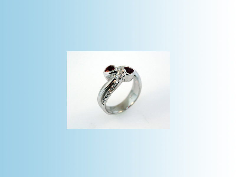 19K White Gold Ruby Ring - Heart shaped rubies set in 19K white gold with round brilliant cut diamond accents