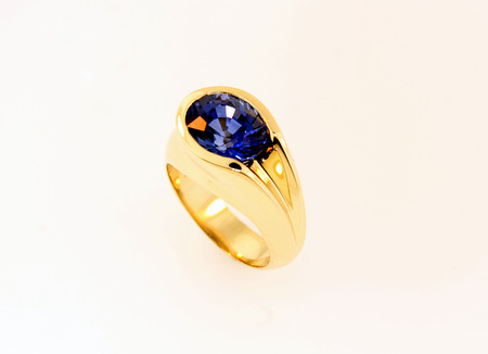 Yellow gold with natural blue sapphire  - Freeform, flowing design. Solid 14K yellow gold set with a natural, treated Ceylon blue sapphire