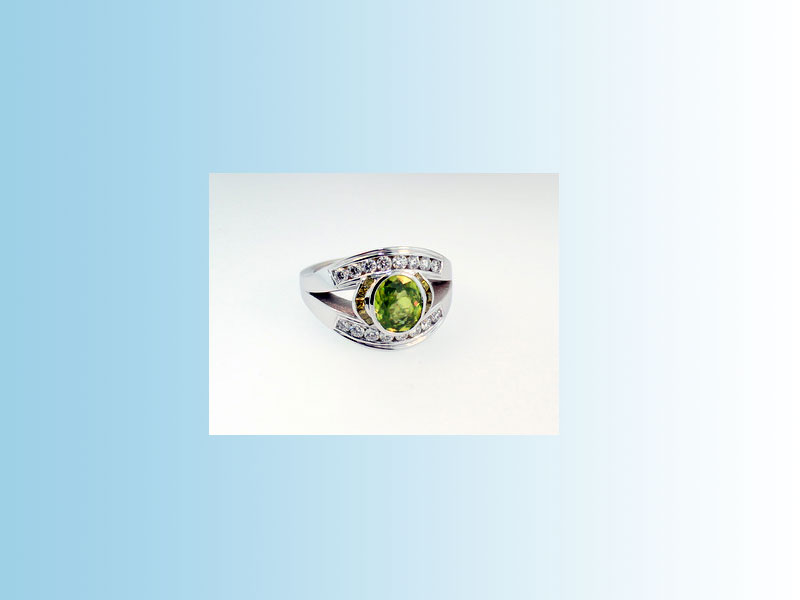 14K White Gold Sphene Ring BGS001 - Split shank design set with round brilliant white diamonds, princess cut yellow diamonds and an oval green sphene in a full bezel. Created for BLUSH JEWELLERY in Victoria, British Columbia. Contact us for more info.